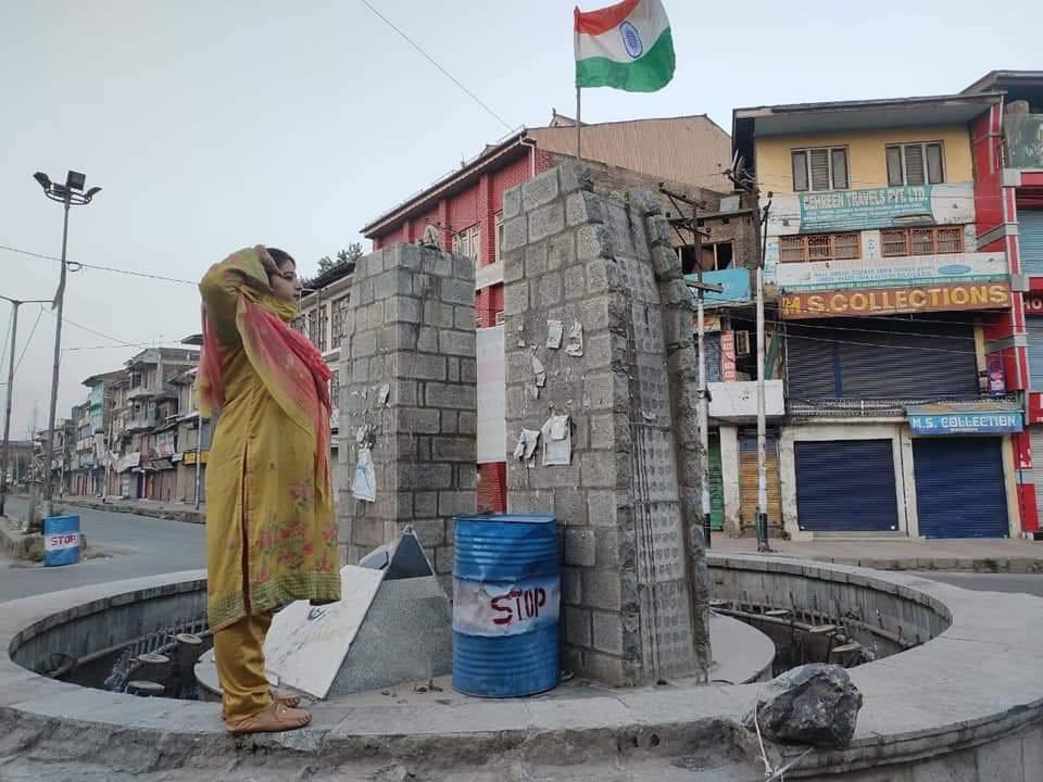 Local BJP Leader Rumisa Rafiq hoists and salutes the Indian tricolour at Lal Chowk in South Kashmirs Anantnag district on the 1st anniversary of Article 370 and 35A abrogation from J&K inspite of repeated threats of Pakistani terrorists and radical separatists.