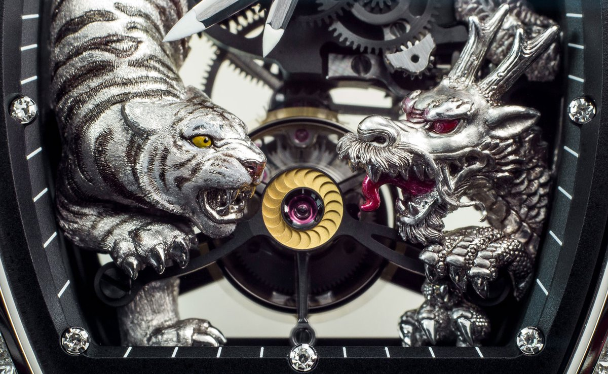 Clutching the tourbillon movement. The Tiger and the Dragon of the RM 51-01 are created from 3N red gold, carved, incised hand painted by hand, increasing the realism of these special animals bit.ly/3hMxEWb #historicalmodels #RM5101