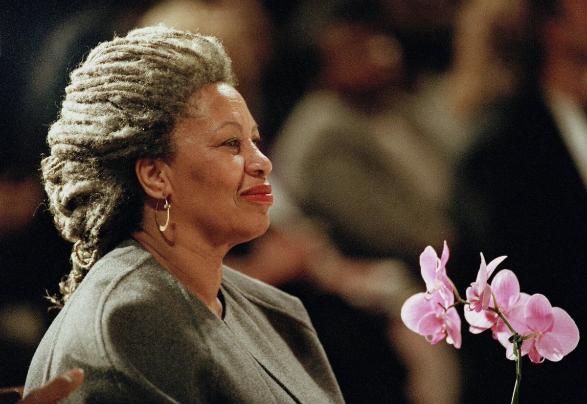 Today makes one year since Toni Morrison passed away (February 18, 1931 – August 5, 2019). We are forever thankful for her life & legacy. 📸: Toni Morrison holds an orchid at the Cathedral of St. John the Divine in New York. April 5, 1994. AP Photo/Kathy Willens.