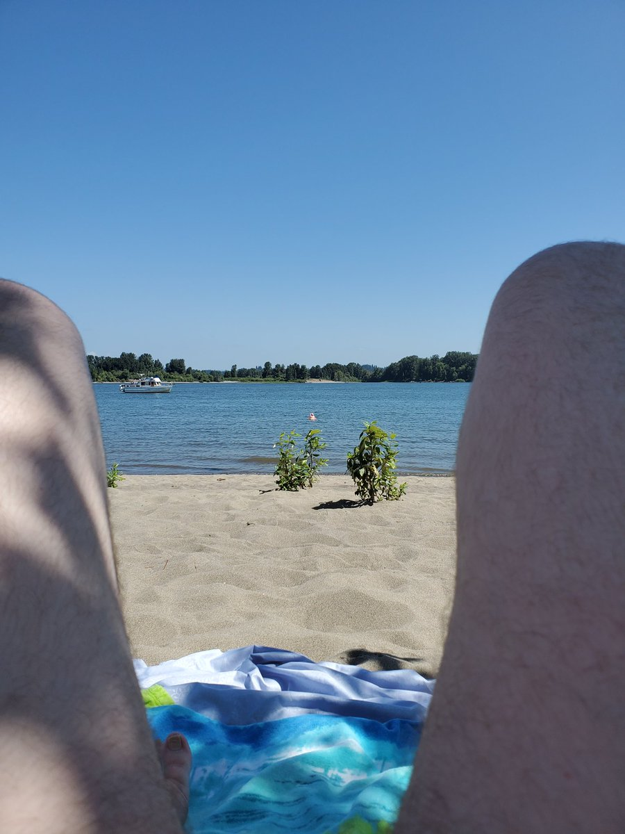 Baby Girl taking a dip in the river while I relax in the shade...or what I thought was the shade. I'm so pale I still burned. Still, lovely day yesterday at #collinsbeach #nudebeach #nudepdx #sauvies #sunburnpic.twitter.com/WHjXdPh697