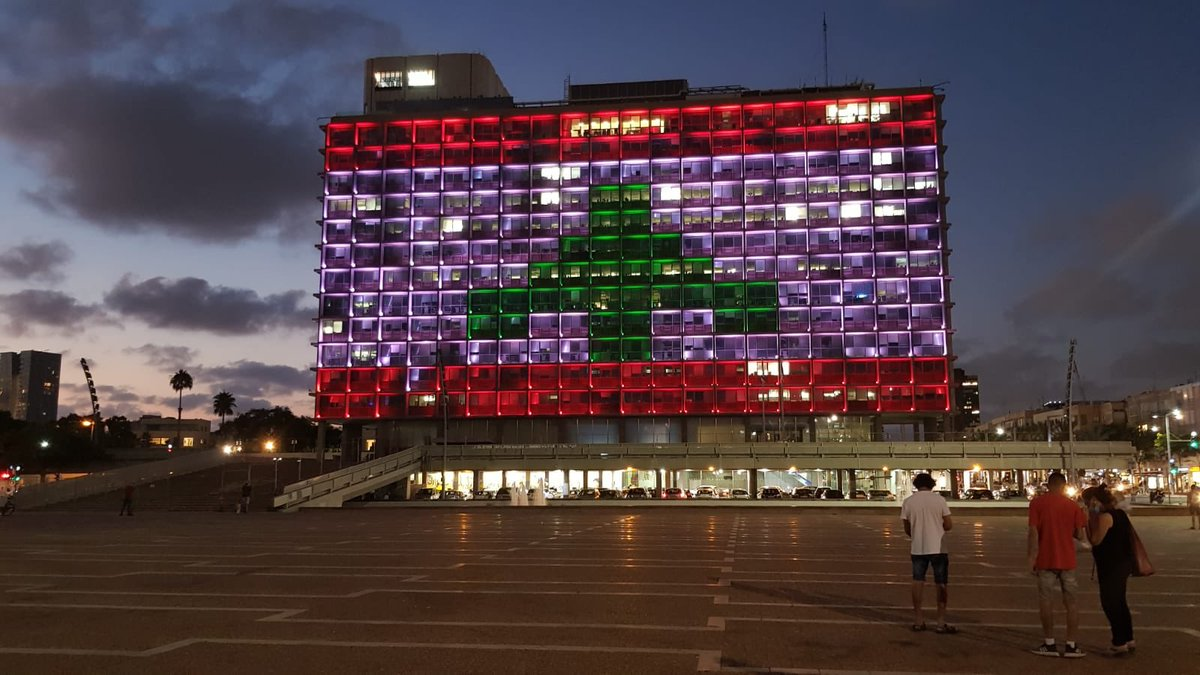 UNITY IN TRAGEDY: Tel Aviv municipality lights up with the Lebanese flag as an act of solidarity following deadly explosion in Beirut which took the lives of at least 100 civilians & left thousands injured. Israel has also offered to treat wounded victims in their hospitals.