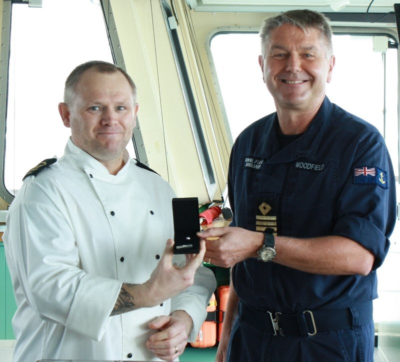 A celebratory day today as Captain Karl Woodfield presents LH(CH) Michael Harding with the Long Service Clasp for having been with the RFA for 30 years. @RFAHeadquarters @RoyalNavy #royalfleetauxiliary