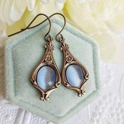 Vintage inspired soft blue & antiqued gold earrings. A few more pairs left in my #etsyshop https://etsy.me/31pkxDP . #vintagestyle #historicalfashion #torontojewelry #handmadejewelry https://instagr.am/p/CDkGxC4BK7g/pic.twitter.com/tIanKimAAy