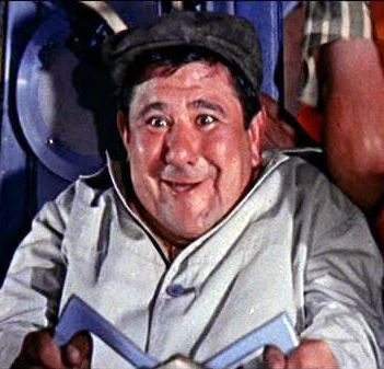 Peter Marshall:  You're in an airplane and you've developed engine trouble.  What do you traditionally say over the radio?  Buddy Hackett:   What the (bleep) am I doing here? #PopCulture pic.twitter.com/DUxZPuA9ba