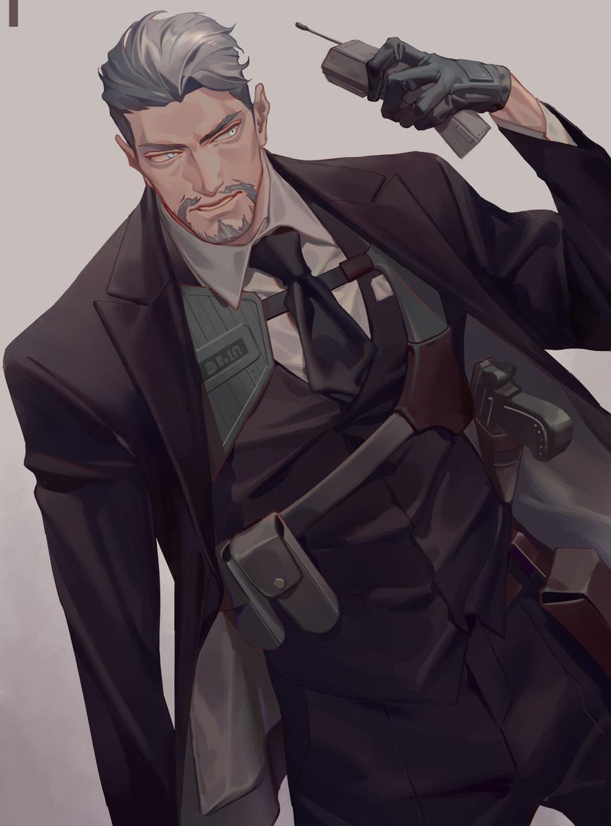 武装スーツおじさん