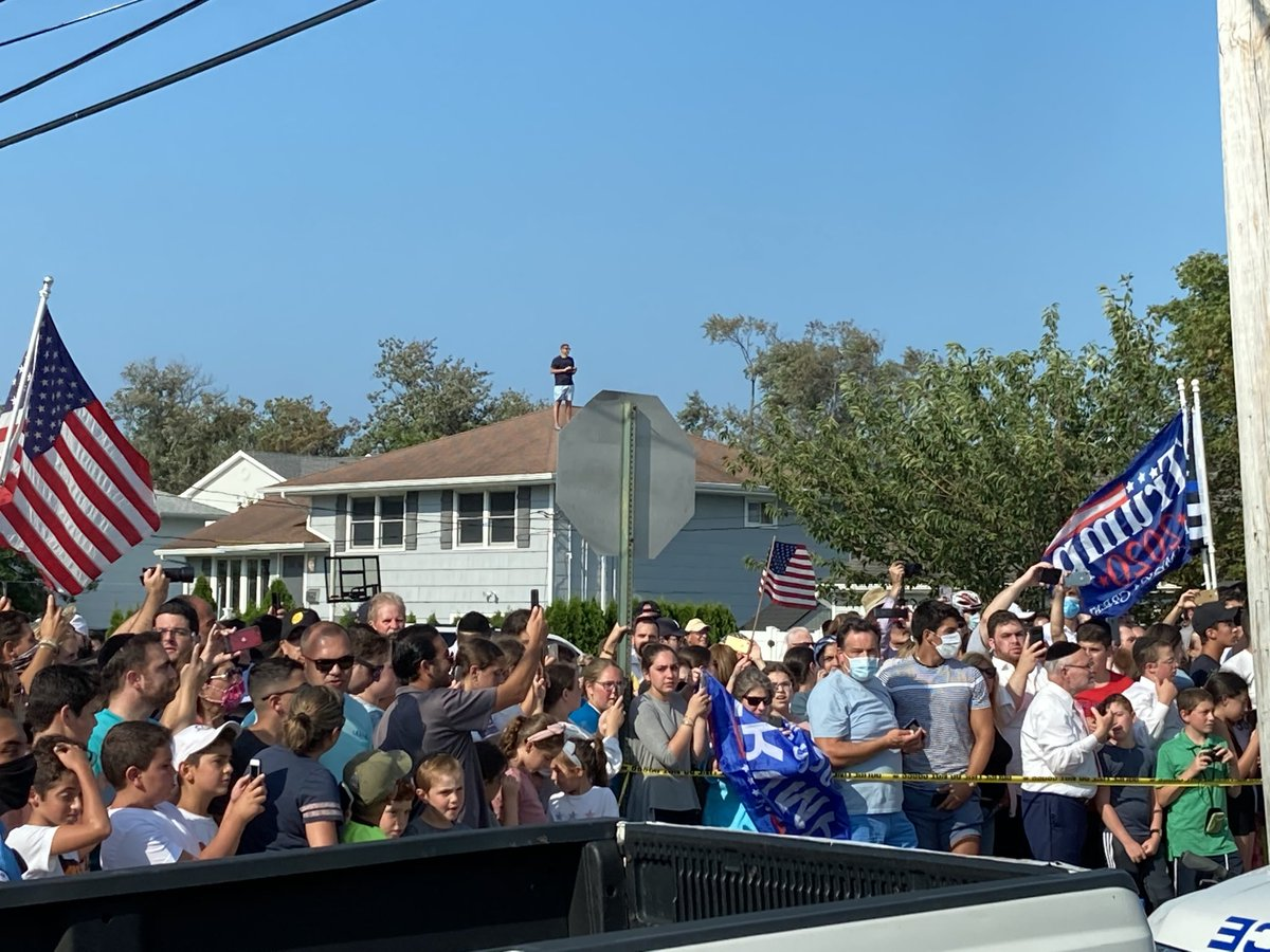 Onlookers in Long Branch cheering the president's arrival. No social distancing, very few masks