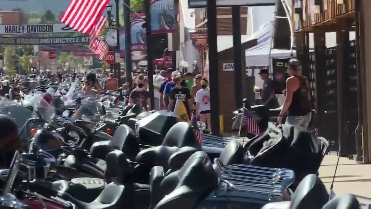 Visitors gather at the Sturgis Motorcycle Rally in South Dakota, where masks are not required.