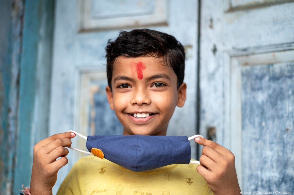 Ujas, 11, proudly shows his mask in India. Until we have vaccines or medicines to stop COVID-19, mask wearing, physical distancing, and hand washing are some of the best tools we have. #WorldMaskWeek