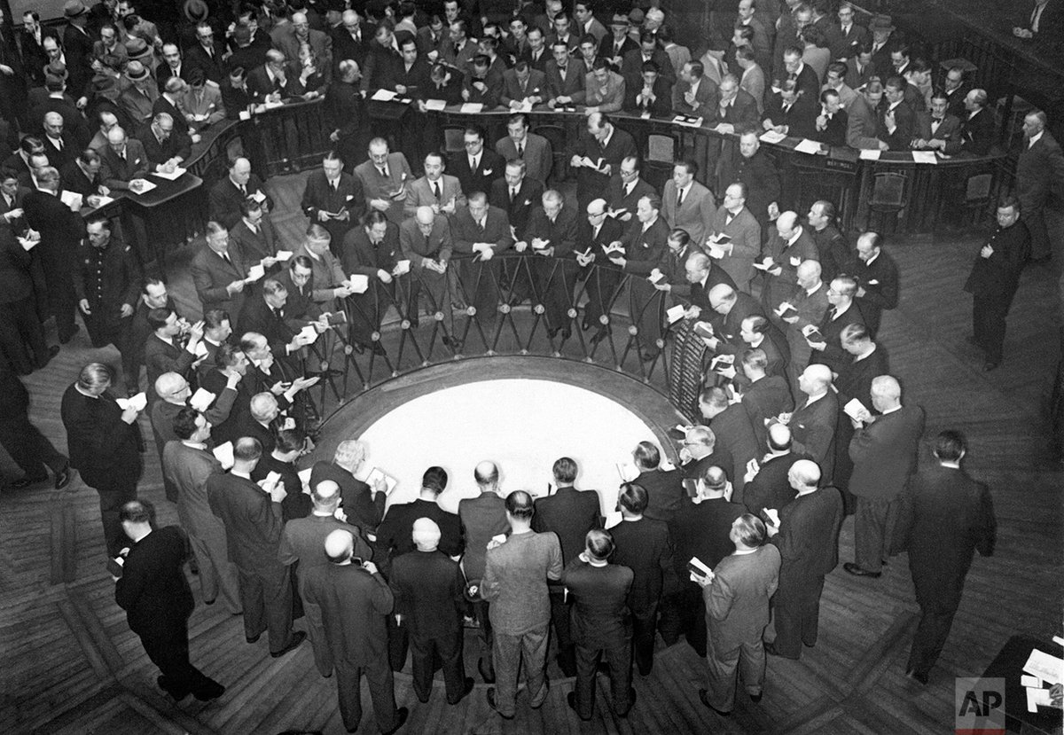 The first day of activity is seen in the reopened Paris Stock Exchange in Paris #OTD in 1940. #APPhotoArchive