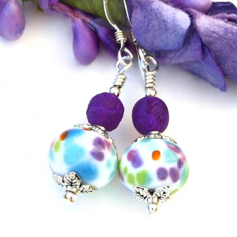 FUN multi-colored dotted #lampwork #earrings w/ dark #purple beads! https://bit.ly/MacchieIM  via @ShadowDogDesign #cctag#Handmade #LampworkEarringspic.twitter.com/acxXJxw9av