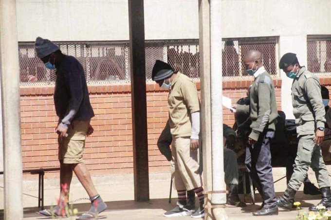 Hopewell and Jacob in chains at Chikurubi Maximum Security Prison