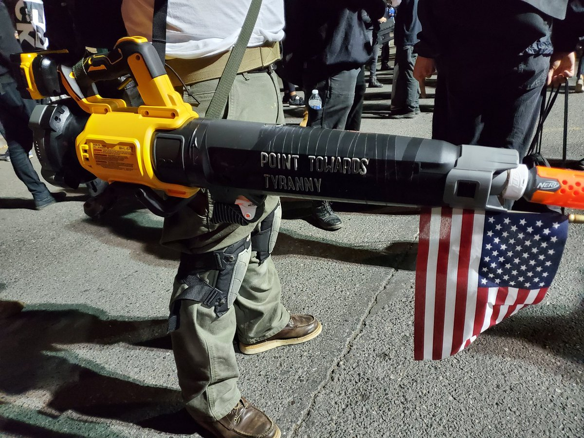A heavily modified leaf blower with 'Point Towards Tyranny' written on the barrel. Beautiful.