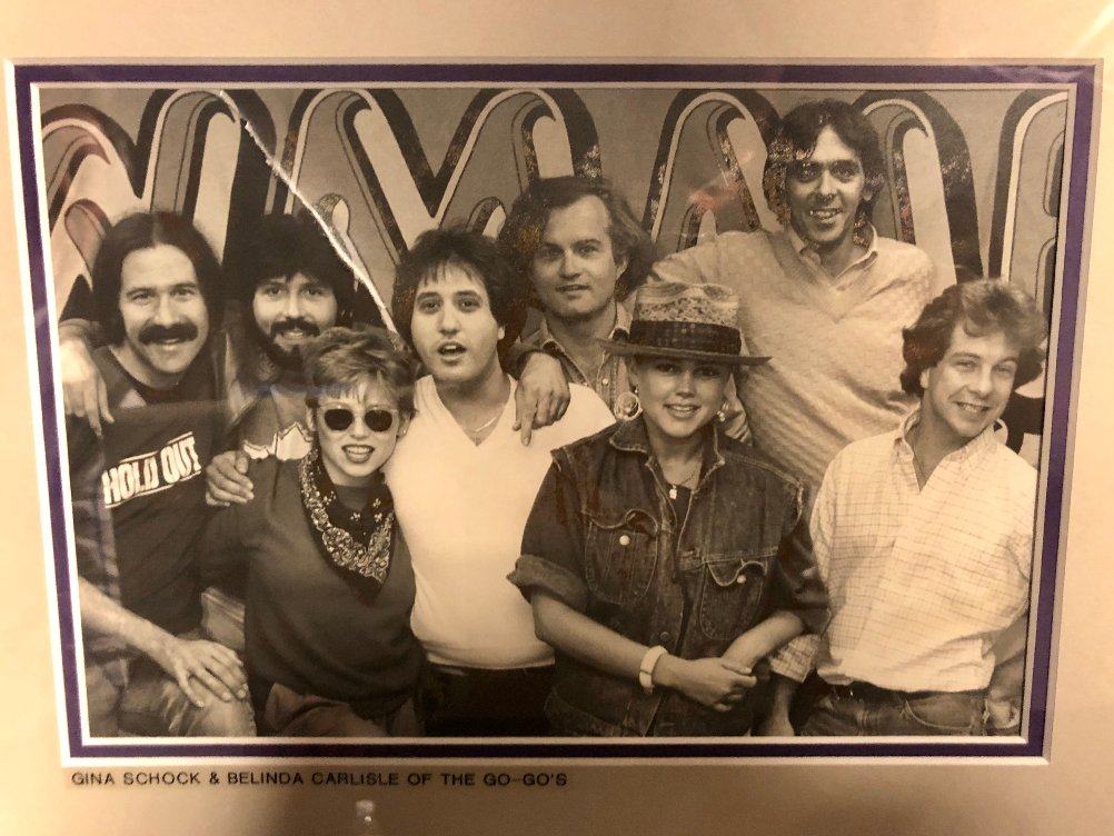 This photo is from a 1982 @OfficialGoGos visit to @933WMMR. From L to R: a young, no-beard kid from SF, label rep Mel Zucker, Gina Schock (who I just interviewed), Joe Bonadonna, Promo Director Tom Sheehey, Belinda Carlisle, legendary PD the great Charlie Kendall & Kevin Gunn. https://t.co/EgR2cB3ztK