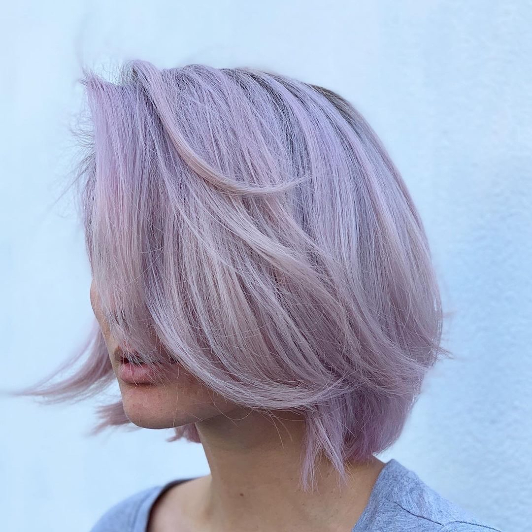 This lust-worthy lilac is sheer perfection. K18 preserved the integrity of the hair during the lightening process, balancing the porosity for even application and pull through.   Color by: @marilynguarino  @bibaacademy  #k18hair