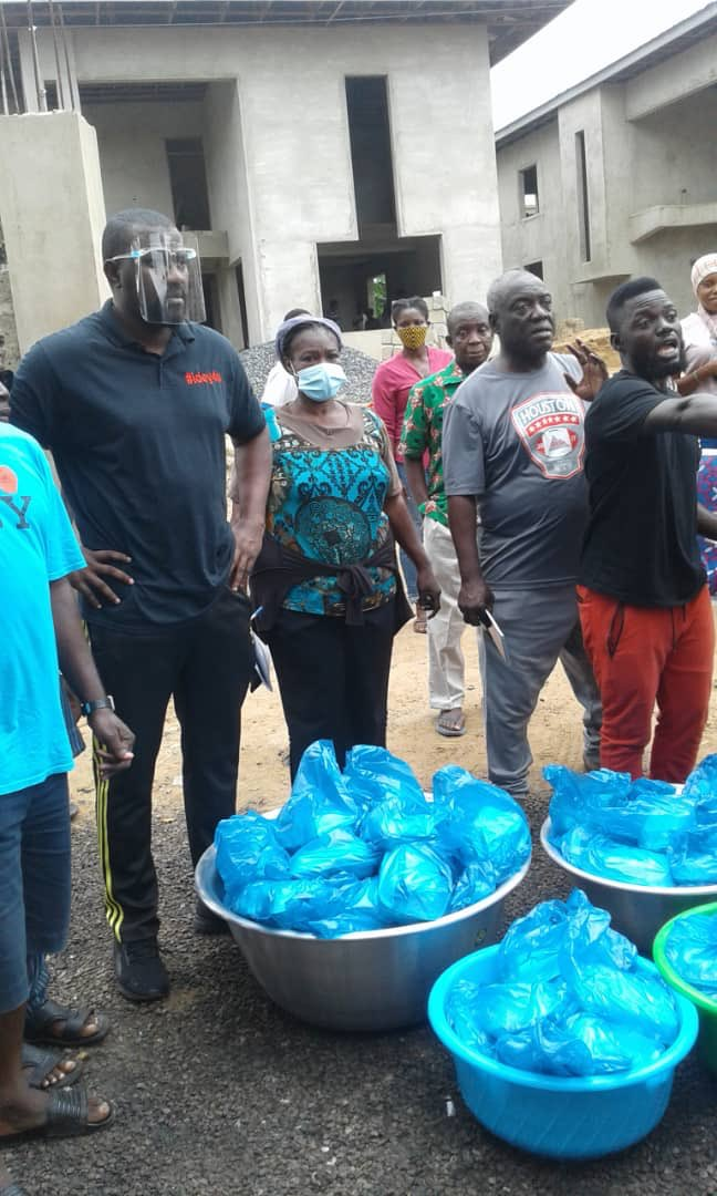 John Dumelo feeds Shiashie residents who were affected by fire outbreak