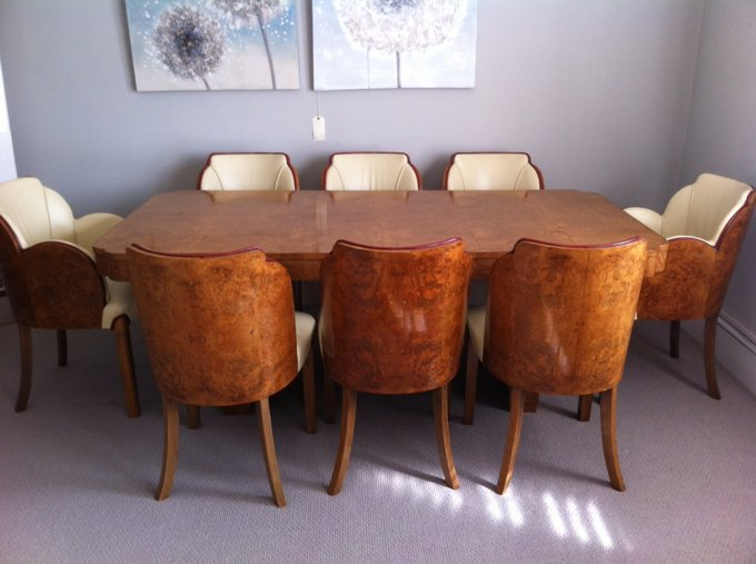 Epstein Brothers Art Deco dining table in burr walnut with eight cloud back chairs and cream leather upholstery, for sale at E & A Wates.