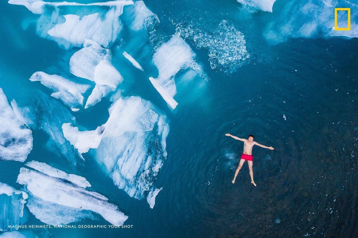 "Your Shot photographer Magnus Heinmets captured this chill-inducing self-portrait while swimming among icebergs in an Icelandic lagoon. ""It was one of my biggest dreams, to visit Iceland,"" he writes. https://t.co/fZWZG1gBs0"