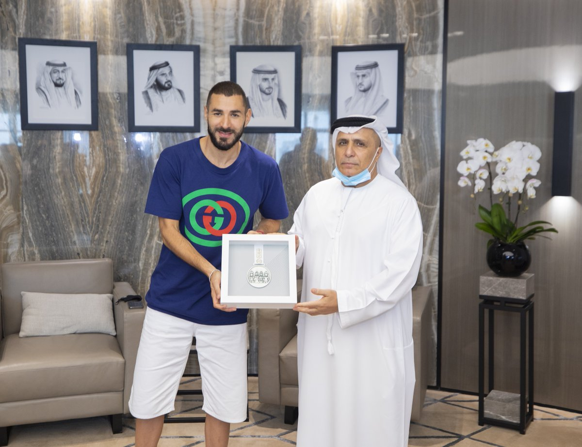 .@DubaiSC presents First Line of Defence Medal to Real Madrid star @Benzema in appreciation of his efforts in supporting community initiatives launched by the Council during the stay-home period at the start of the COVID-19 pandemic. #Dubai https://t.co/yZ39o6nv5d