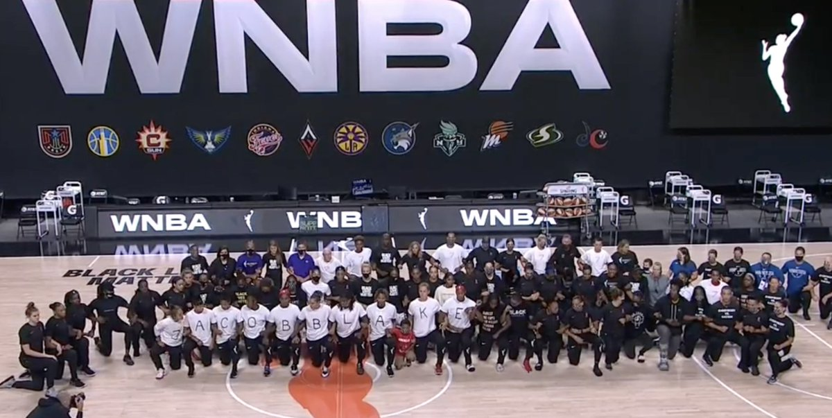 WNBA players from the Mystics, Dream, Lynx, Sun, Mercury and Sparks take a knee and lock arms while wearing shirts that spell out Jacob Blake  No WNBA games will be played tonight.