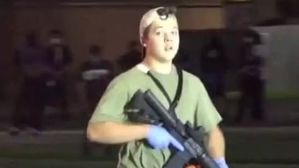 This is Kyle. He is white. He is armed. He is accused of killing two people. Police arrested him without shooting him.  Question: How come police had to shoot an unarmed Black man 7 times but could arrest an armed white teen without firing a single shot? @realDonaldTrump https://t.co/zIlJhfkcYd