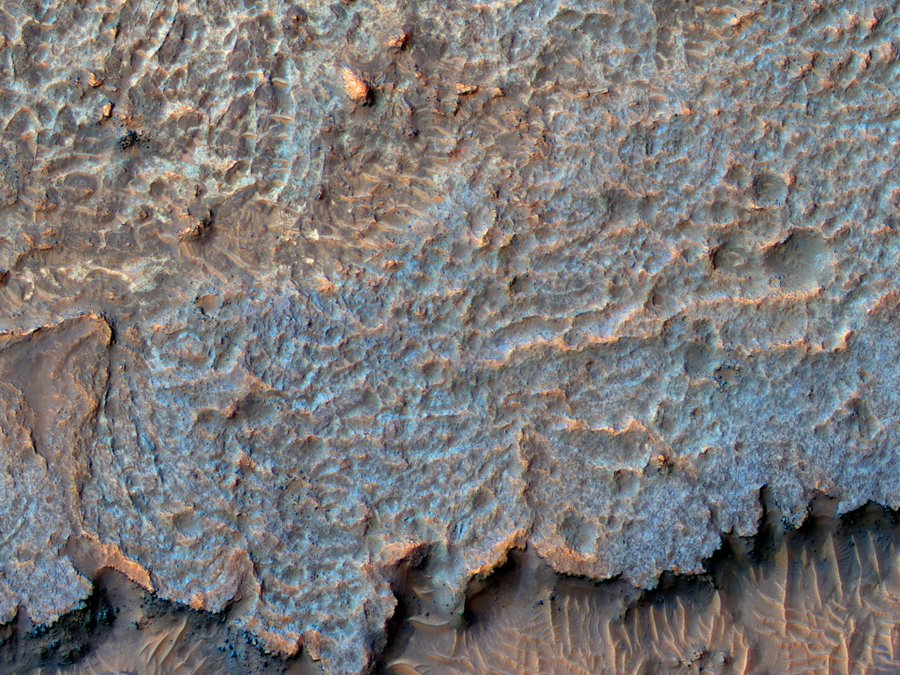 This image covers plains near Aureum Chaos. A puzzling ridged texture was first seen in an image from the Context Camera on MRO, leading to this suggestion for a HiRISE picture. (NASA/UArizona)