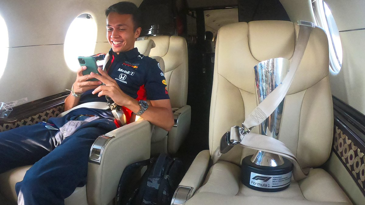 Destination: MK ✈️ @Alex_Albon returns home with an extra special piece of cargo 📦🏆 #ChargeOn 🤘