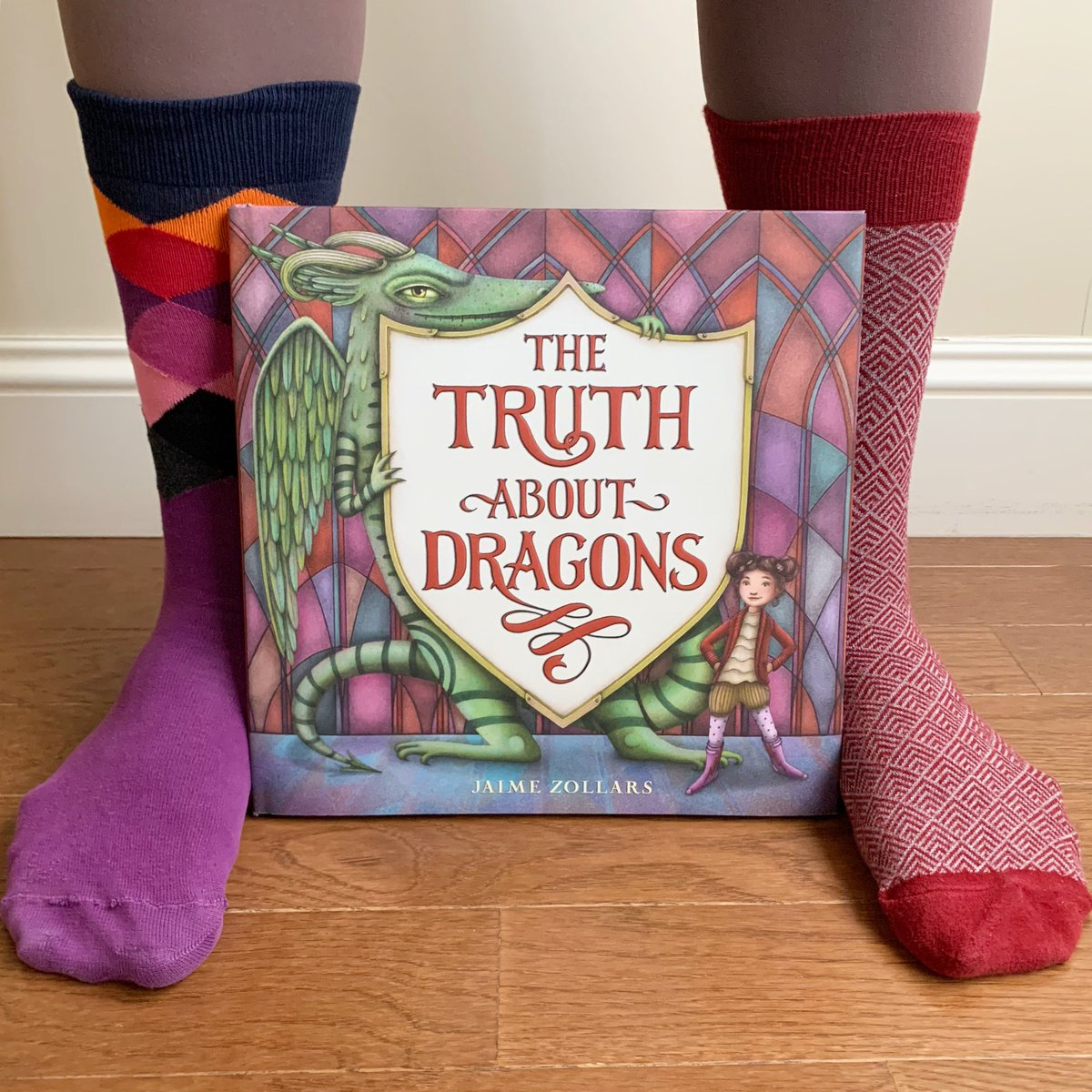 Celebrating a very special #bookbirthday with appropriately mismatched socks!  Congratulations @jaimezollars on THE TRUTH ABOUT DRAGONS publishing today! 🎉 https://t.co/UVOQvr6FXz