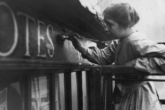 UK campaigner for the suffragette movement and artist, #SylviaPankhurst painting onto the façade of the Womens Social Defence League shop in Bow Street, London, 1912 and self portrait in a prison dress (right) #womensart