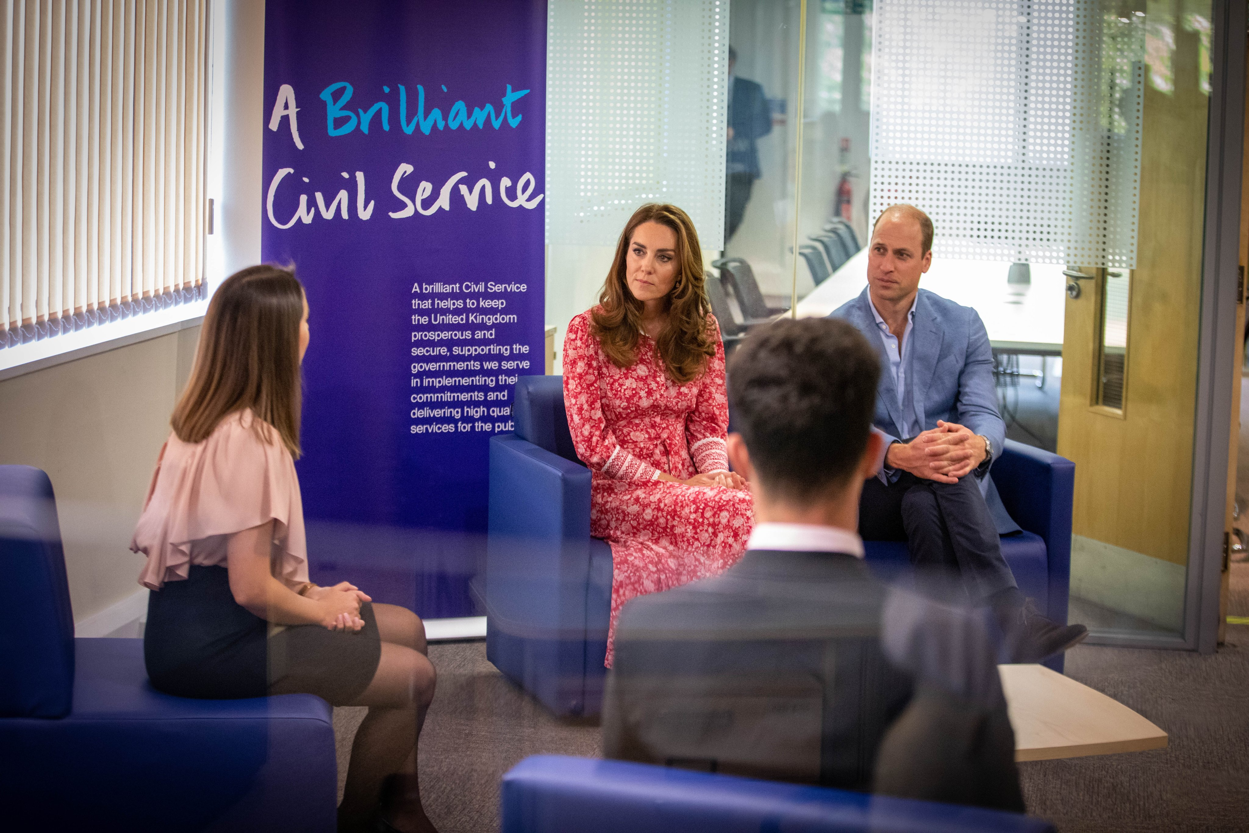 HRH The Duke and Duchess of Cambrige sit and talk with Anife, a newly appointed Work Coach.