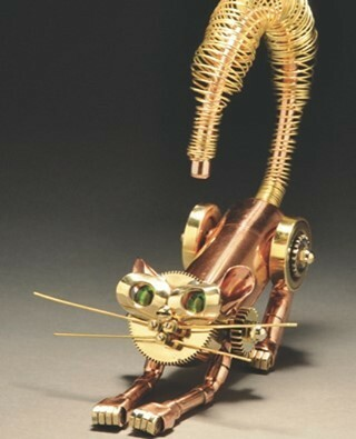 #Steampunk ⚙️ Awesome of the Day: Upcycled #Cat 🐱 With Green #Glass Eyes 👀 #Sculpture By John Belli via @Glamour365 #SamaCuriosities 👀