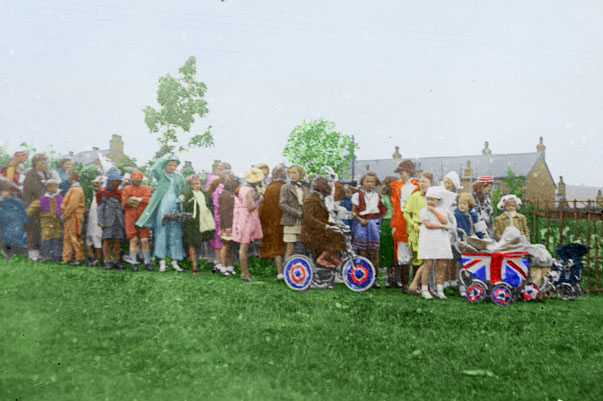 Lining up for the V E Day fancy dress parade in Furness Vale. Digitally colourised by https://t.co/AKNis5kvdz #VEDay #Derbyshire #FurnessVale https://t.co/34q1qL6gRd