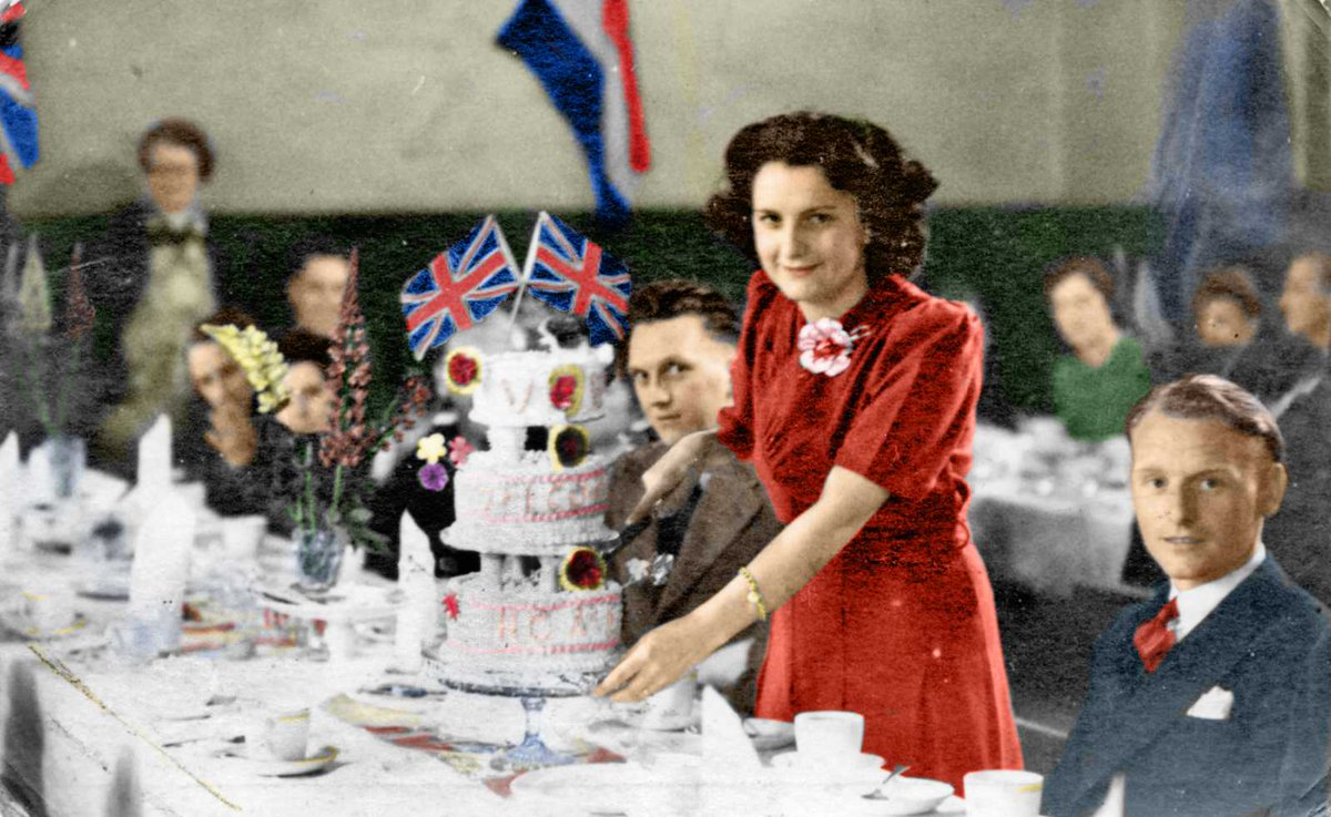 Margaret Graham cuts the cake at the V E Day celebration dinner in Furness Vale. Digitally colourised by https://t.co/AKNis5kvdz #VEDay #Derbyshire #FurnessVale https://t.co/qzuseNoPtI