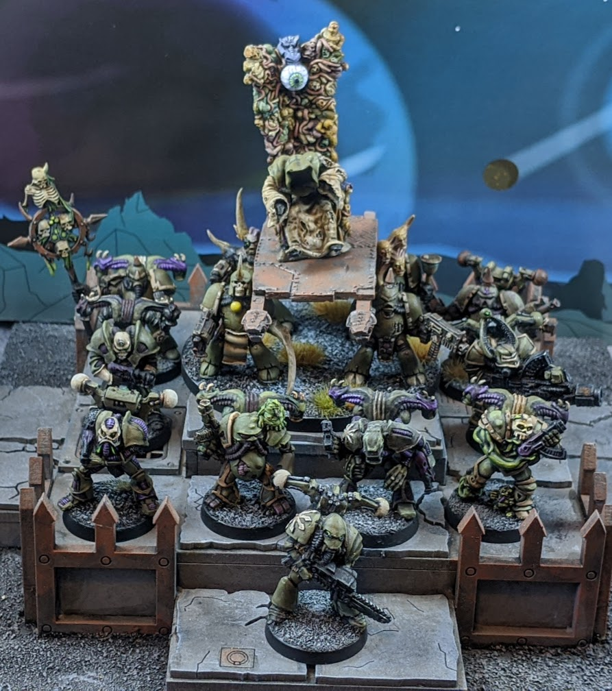 Here's another one: a group shot of some #oldhammer (plus or minus some conversions) and #middlehammer #DeathGuard led by classic Citadel Middle-Earth model my wife found for me for a quid in a charity shop.   #PaintingWarhammer https://t.co/x55hB3DPAg