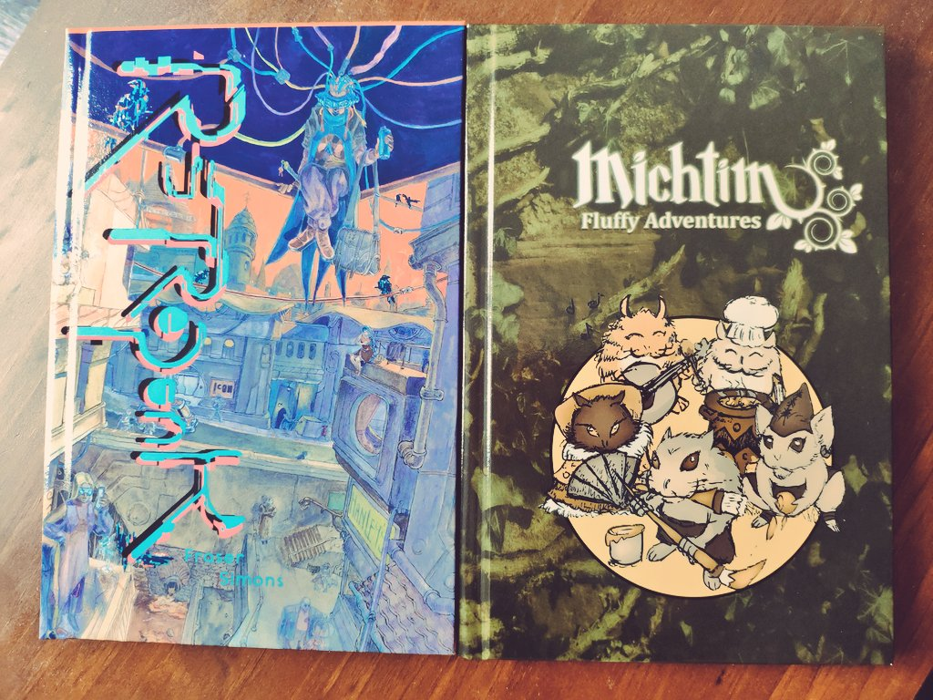 New PoD books from @DriveThruRPG has arrived. ❤️ Retropunk by @frasersimons and Michtim by @GrimOgreLabs (I've purchased the pdf of Michtim previously, but I prefer having something to hold in my hands.) https://t.co/fAxzhTxFas
