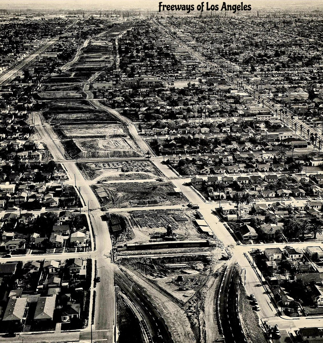 1957-April-15 - Looking south over Harbor Fwy (then US-6/CA-11, now I-110) construction at Century Blvd (foreground); note freeway terminus at bottom. Broadway at left; Figueroa St at right (DOH D7 Archives photo). https://t.co/UxpFfGHX7P