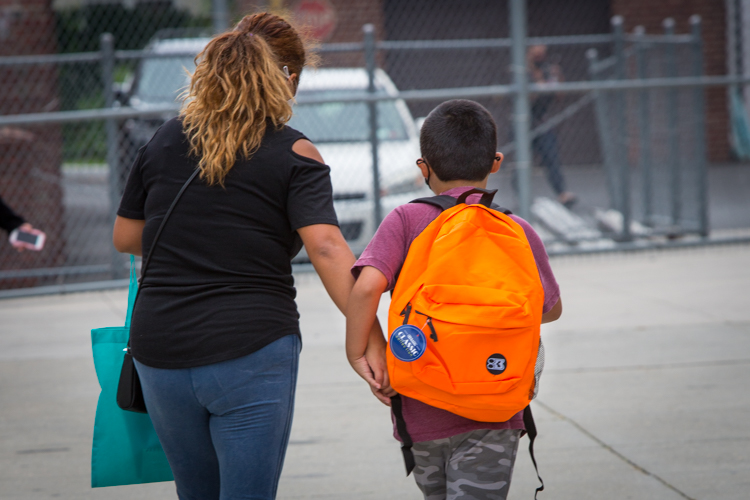 A student leaves with a new bright orange backpack at the PS 329 @PrideEast backpack giveaway in East Elmhurst, Queens, on Saturday. #HereForOurKids https://t.co/pBKKX6BKia