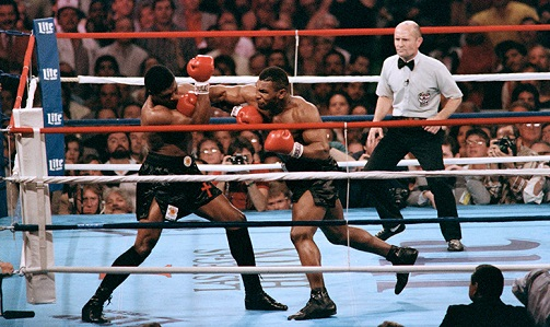 """A 20-year-old """"Kid Dynamite"""" slams the late Trevor Berbick with a hard right hand in #LasVegas in 1986. Tyson capped an amazing 13-0 year with a title-winning 2nd round KO of Berbick to become the youngest big man champ ever. #Heavyweight #History #Boxing #MikeTyson #Legend https://t.co/oGtr7jWrsZ"""