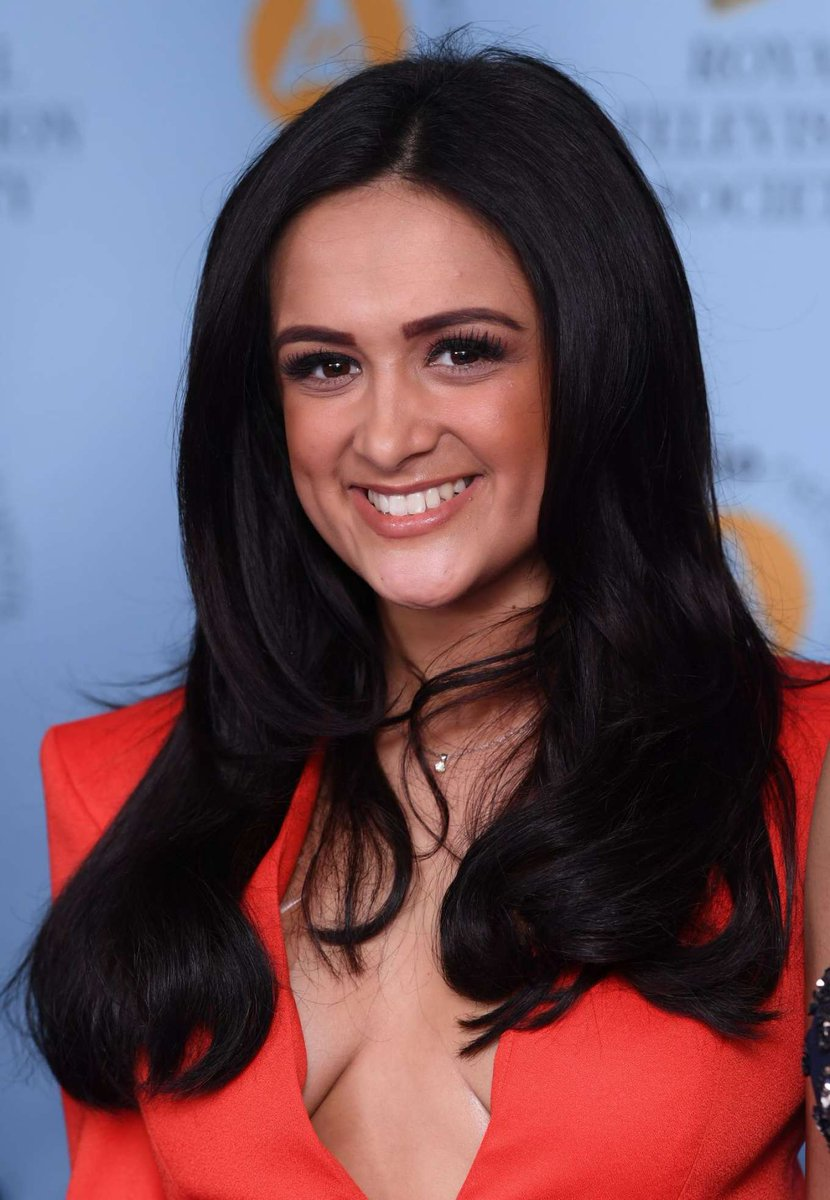 Red carpet photo of Amy-Leigh Hickman with a beaming smile