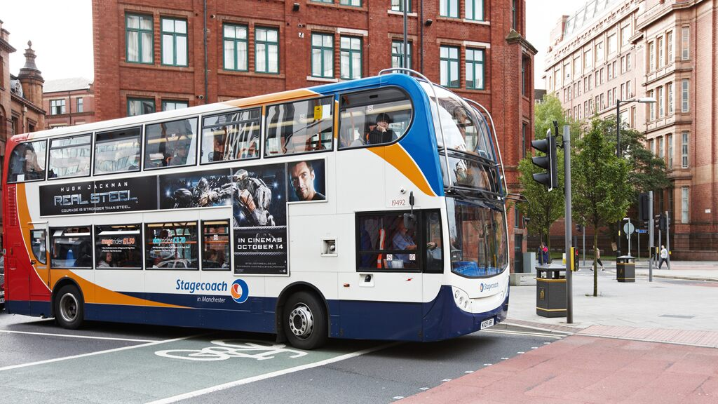 man-using-live-snake-as-face-mask-boards-bus-in-england Photo