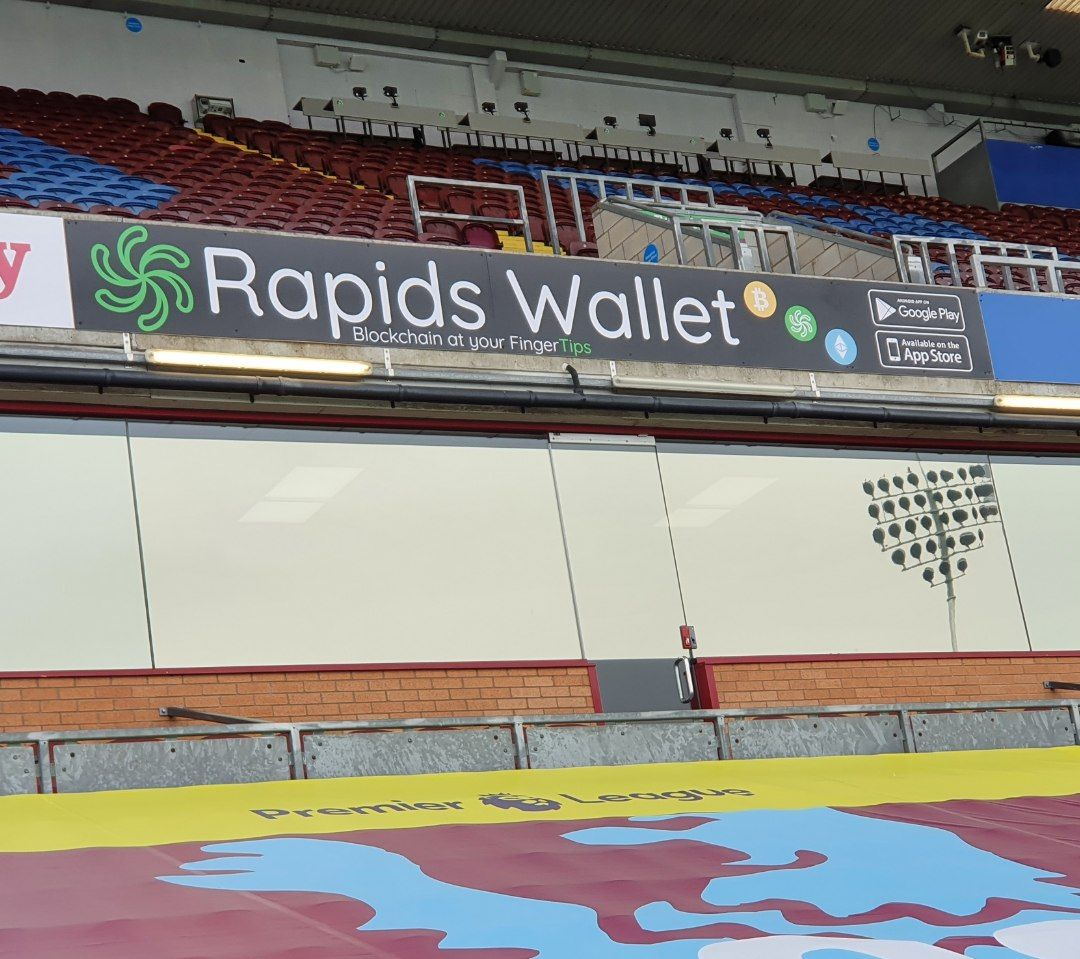 Rapids Wallet reaches millions!  We're thrilled to announce our friends at @BurnleyOfficial have supplied us with a huge banner within their stadium advertising our revolutionary Mobile Wallet!  Look out for how we'll be maximising our reach every game.  #BurnleyFC #RapidsNetwork https://t.co/BgEJIauIUR