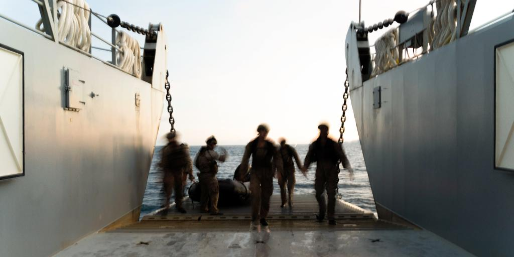 Blurred Motion Marines with 3rd Marine Division board a Landing Craft Utility during F470 Combat Rubber Raiding Craft training at White Beach, Okinawa, Japan, to increase proficiency with launch and recovery for covert insertion and extraction of reconnaissance teams.