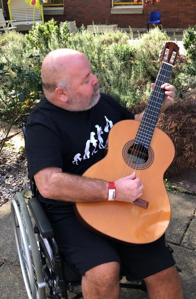 Remember John and Alex? Occupational therapist Alex made John a mock guitar neck to practice after glioblastoma affected his left side. Look at him now! Enjoying the sun and starting to play again thanks to the amazing staff at Castle Hill Hospital #OccupationalTherapy @theRCOT https://t.co/ZEoNk7p8xZ