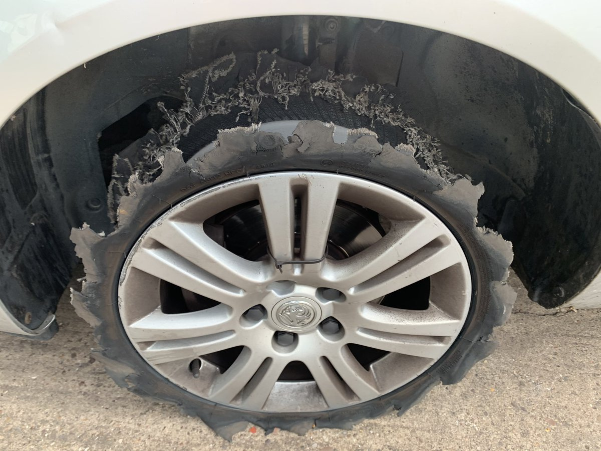 A customer came to the garage morning worried about a knocking noise on passenger side front. We asked the customer to drive the car in but wasn't expecting this. Without doubt the worst condition of a tyre we've ever seen, whatever is left of it!!