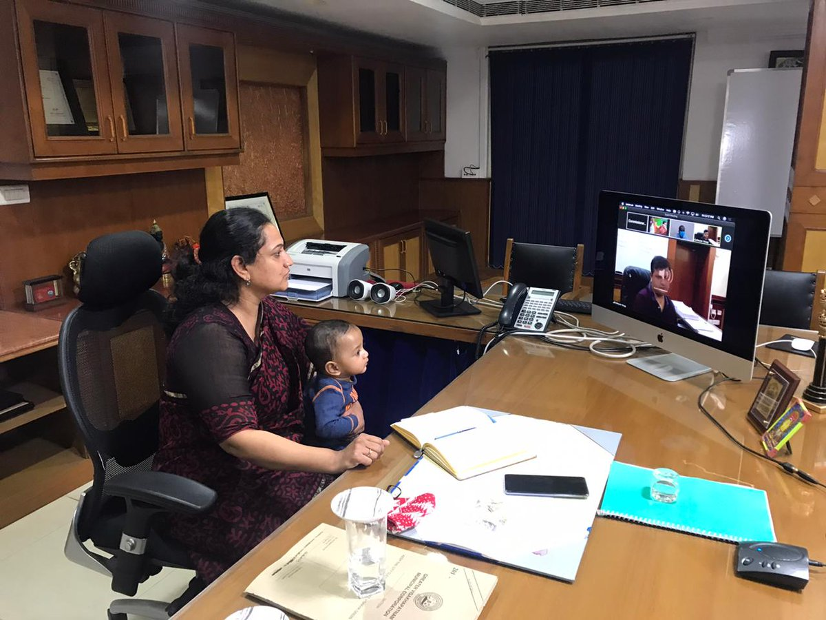 Commissioner GVMC Dr. G. Srijana attended the video conference with higher officials while nurturing her child.