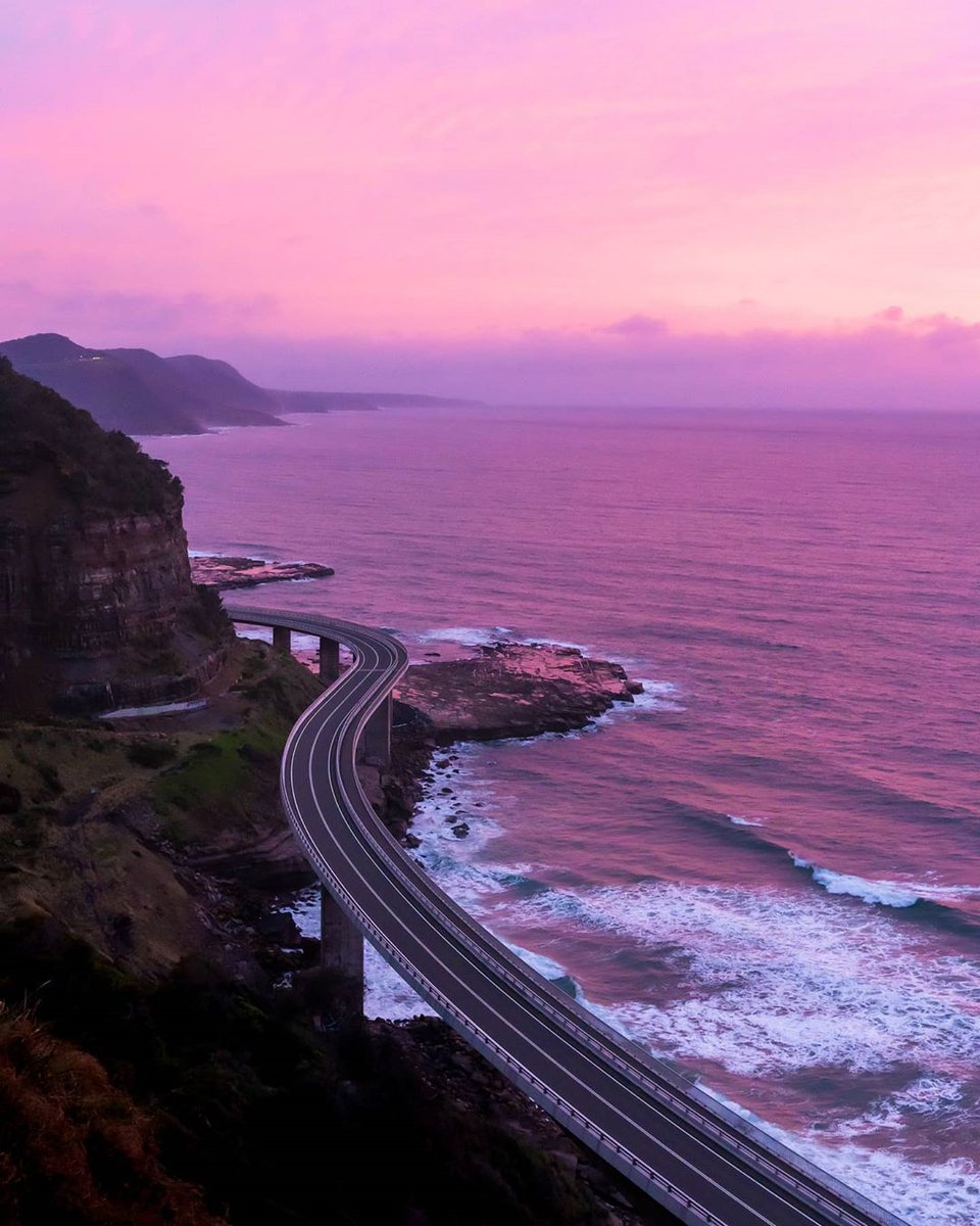 Windows down, volume up - we're going on a road trip 👌🏽   IG/mani.b.singh captured @NewSouthWalesmagnificent coastline at sunset recently, featuring the famous #SeaCliffBridge near @Wollongong_City, around 90 minutes south of @sydney_sider.  #seeaustralia #NewSouthWales https://t.co/peY8jRgN0b