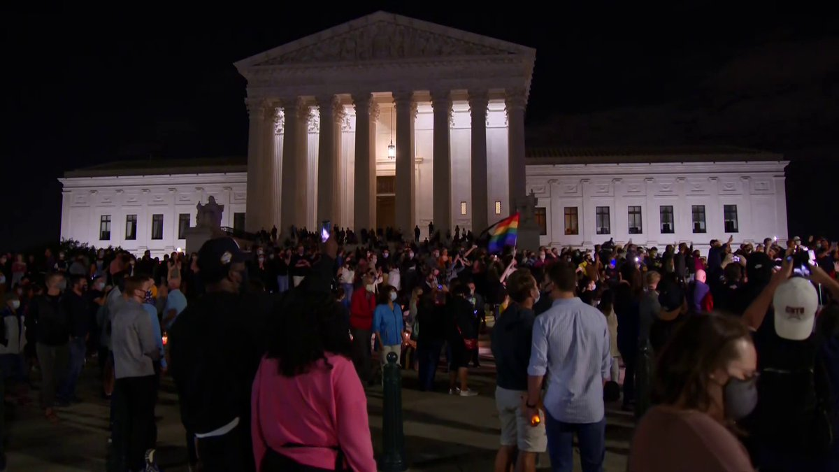 "Mourners outside the US Supreme Court chant ""RBG"" on the night of Justice Ruth Bader Ginsburg's death."