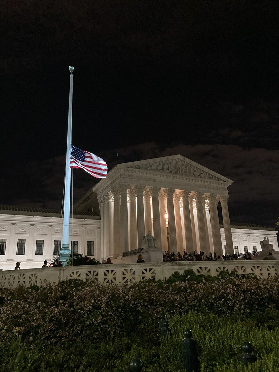Outside the Supreme Court tonight flag is at half mast in memory of Justice #RuthBaderGinsburg   People are lighting candles to celebrate her dedication to Justice. https://t.co/wiKTvnbQie