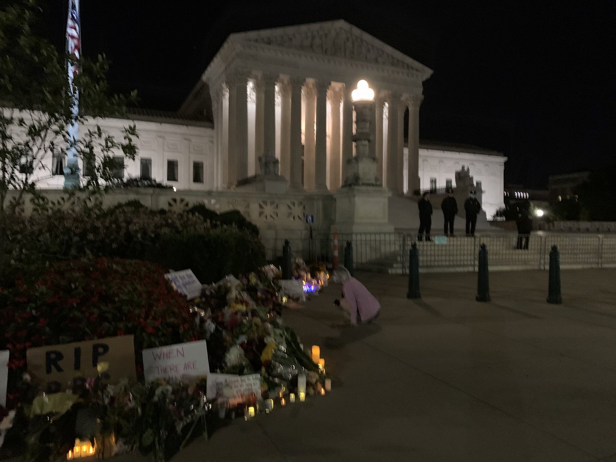 This morning there is a memorial forming just off the steps of the Supreme Court in honor of #RuthBaderGinsburg - I spotted one young woman crying at 4am after seeing the signs, candles, and cards left to honor the late justice. https://t.co/H4nVCBFSM5
