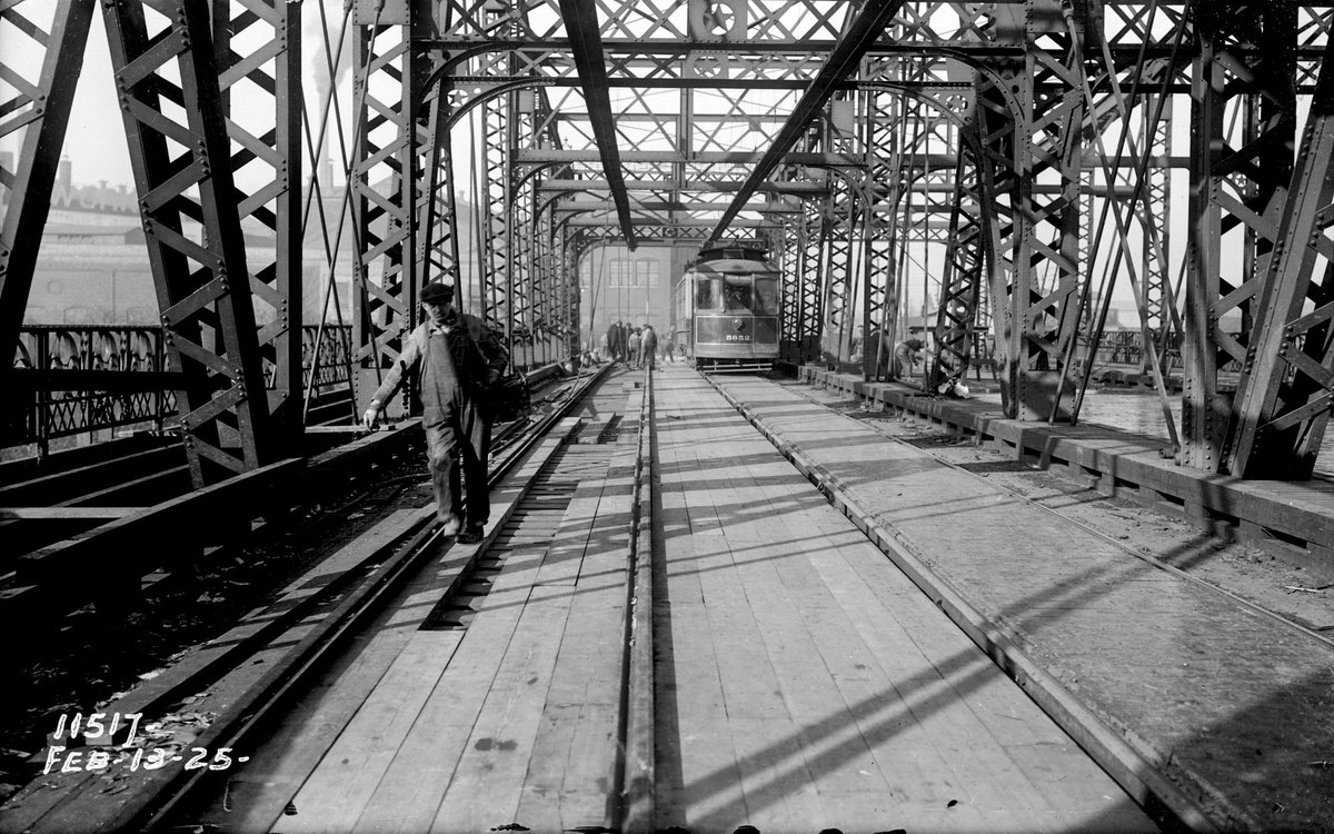 Historical Photo of the Day: The Western Ave Bridge over the Chicago Sanitary and Ship Canal in #Chicago, looking north, showing the laying of timber for paving on Feb 13, 1925 @cta @ForgottenChi @ChicagoMuseum #engineering #labor #cookcounty #illinois https://t.co/sj14cD1eSD
