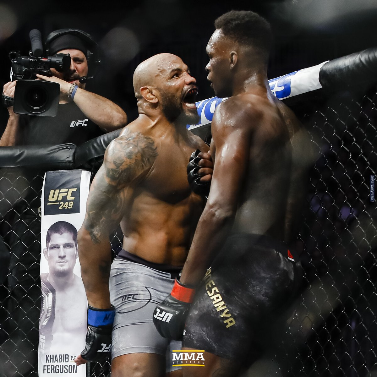 Doing the asset pulling for our #Timeline series always helps me revisit photos I've taken. This one from #UFC248 I love not just for the yelling but that the cameraman, Nick, is also reacting [bonus of cursed Khabib-Ferguson art in the BG]. https://t.co/LElq5zty01